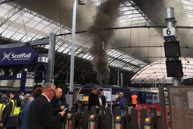 Smoke billowing from the train at Queen Street station