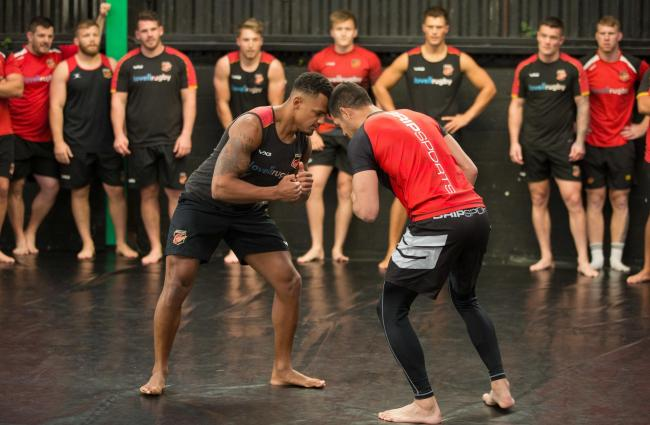 READY TO GRAPPLE: Dragons wing Ashton Hewitt enjoying a training session at Newport MMA