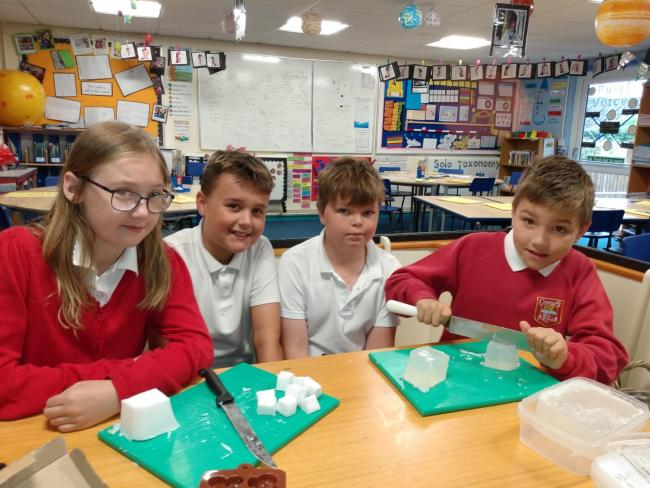 Amelia Hutnick, Charleigh Gunter, Danny Williams and Alfie Allaway making palm oil free soap at George Street Primary School