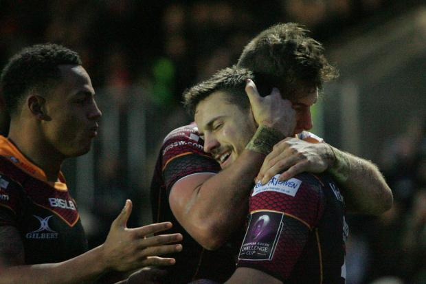 Free Press Series: TRY TIME: Dorian Jones is congratulated after a try for the Dragons