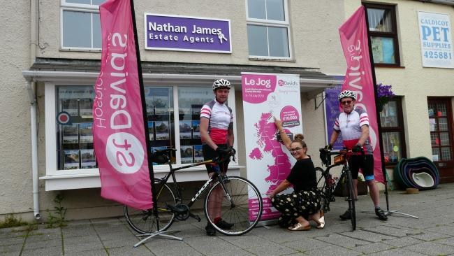 Lejog: Beth Harrington, of St David's Hospice Care, shows Nathan (left) and Andy the Lejog route outside Nathan James Estate Agents, Caldicot. Picture: DBPR