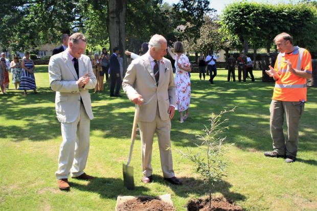 Free Press Series: Prince Charles plants a tree in Llanover village. Picture: courtesy of Ross Murray