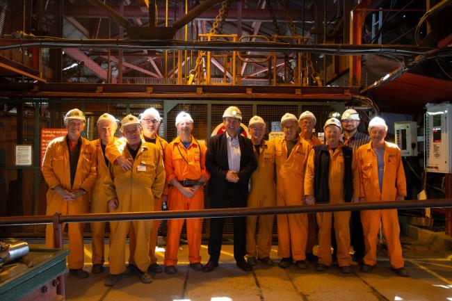 Roger Lewis, president of Amgueddfa Cymru – National Museum Wales, with workers at Big Pit National Coal Museum. Picture: Big Pit
