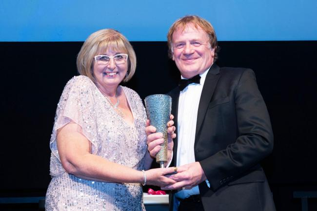 Welsh actor Mark Lewis Jones presented the Arts and Business Cymru Business of the Year Award to WPD's Karen Welch who managed the projects