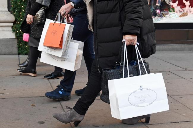 File photo dated 04/12/16 of shoppers. The high street suffered a bleak July as soaring temperatures failed to boost sales, while online retailers saw their strongest growth for 18 months. PRESS ASSOCIATION Photo. Issue date: Friday August 9, 2019. Shoppe