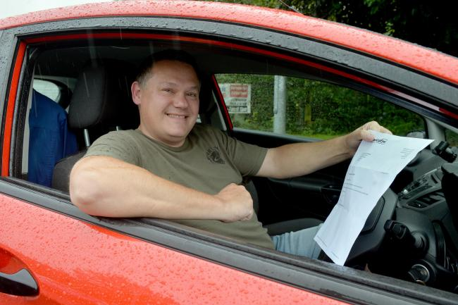 Shane Hatherall celebrating having had his parking fine cancelled .  www.christinsleyphotography.co.uk