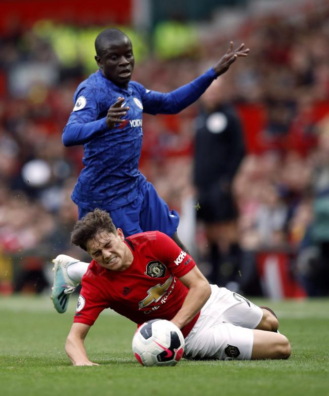 Chelsea's N'Golo Kante fouls Manchester United's Daniel James during the Premier League match at Old Trafford, Manchester. PRESS ASSOCIATION Photo. Picture date: Sunday August 11, 2019. See PA story SOCCER Man Utd. Photo credit should read: Ma