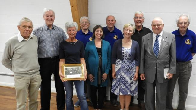 Di Davies and Gareth Davies with members of the musical team, committee and choir archivists along with president Gordon Mudford and Patron Haydn Burgess