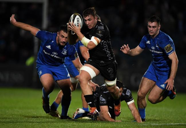 FIGHTING SPIRIT: Back row forward Taine Basham on the charge for the Dragons at Leinster