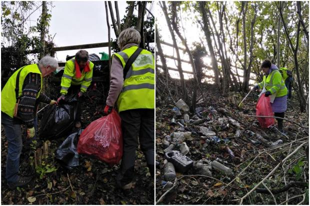 Volunteers clearing the embankment behind the A4042 lay-by. Picture: Ron Ford