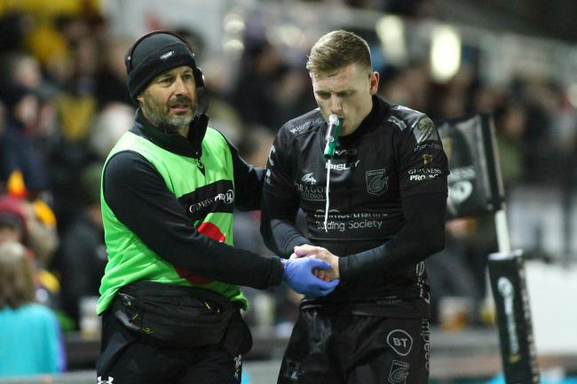 INJURY BLOW: Dafydd Howells is helped from the field