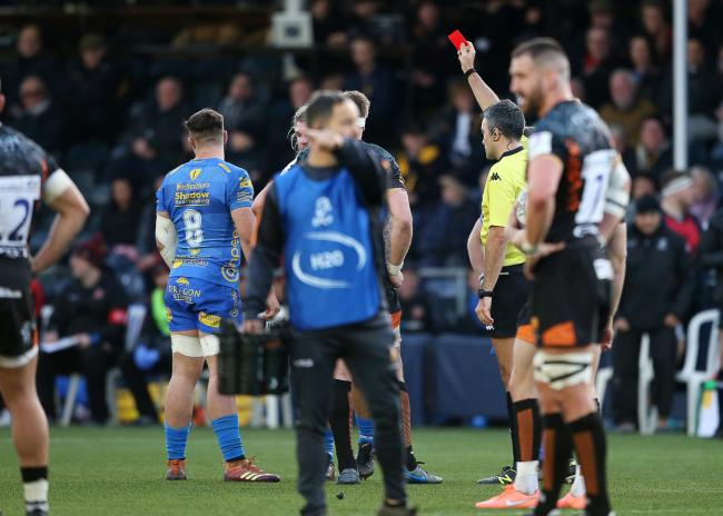 DISMISSED: Dragons back row foward Taine Basham is shown a red card by referee Marius Mitrea in Worcester
