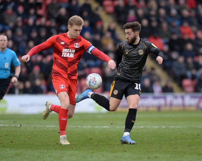 RIVALS: Josh Sheehan battles for possession in Newport County's clash at Leyton Orient in January