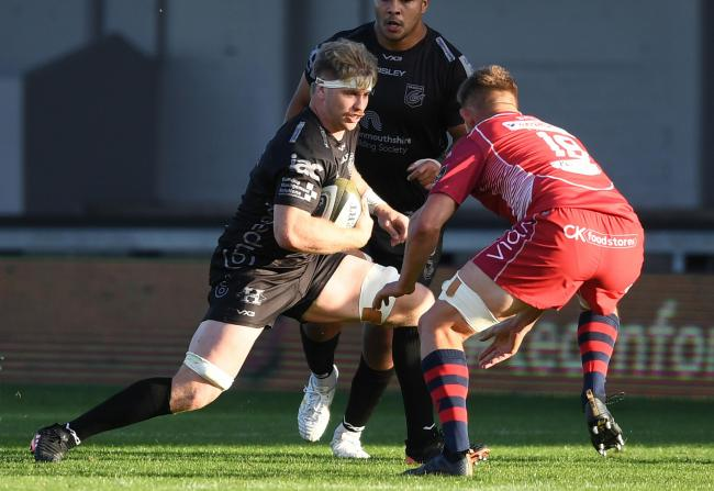29.08.20 - Dragons v Scarlets - Guinness PRO14 -.Aaron Wainwright of Dragons is tackled by Javan Sebastian of Scarlets..