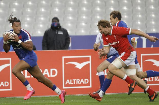 OUTLASSED: France's Teddy Thomas races clear to score against Wales in Paris