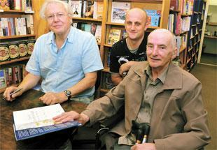 WARM WELCOME: Sir David Attenborough signs a copy of his latest book New Life Stories at the Chepstow Bookshop. Pictured with him are Tony Wells (right) and Alan Wells, centre