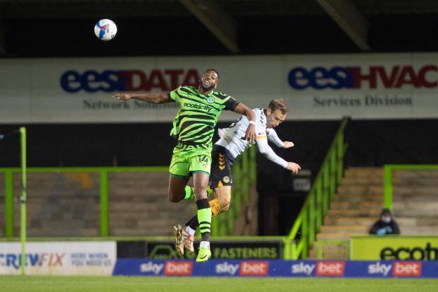 PHYSICAL: Forest Green striker Jamille Matt puts himself about against County's Mickey Demetriou in December