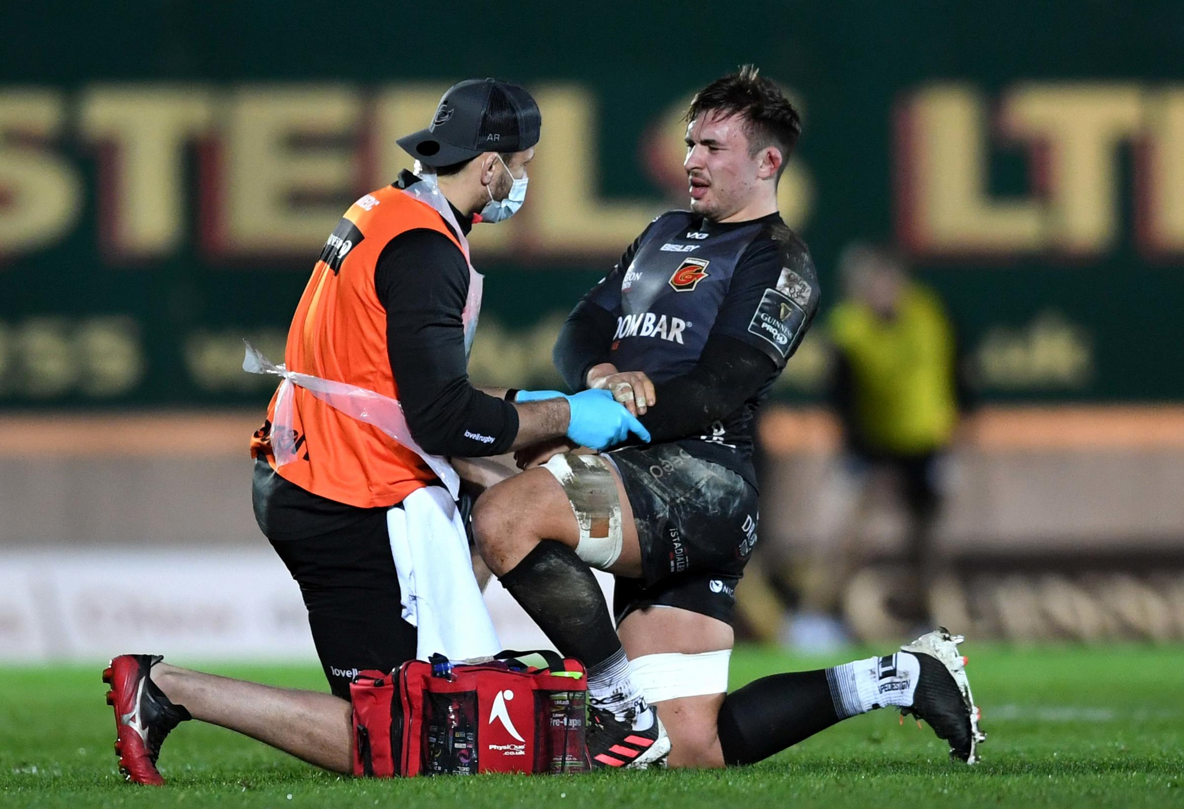 BLOW: Taine Basham suffered a fractured forearm in the Dragons loss at the Scarlets