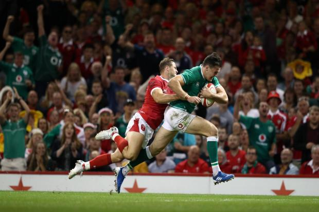 Ireland wing Jacob Stockdale outpaces Hallam Amos to score the second Ireland try. Picture: Stu Forster/Getty Images