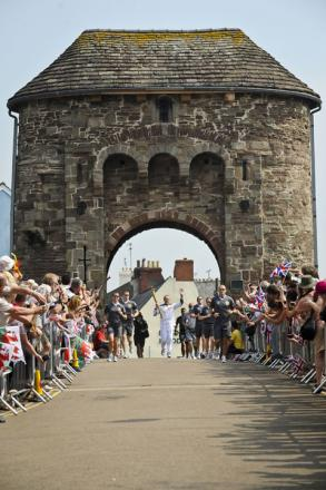 HISTORIC: The torch is taken through Monnow Bridge today