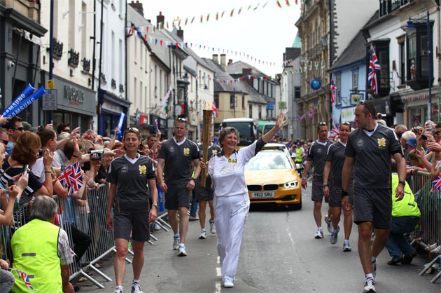 Lyn Hull carries the torch through Abergavenny town centre
