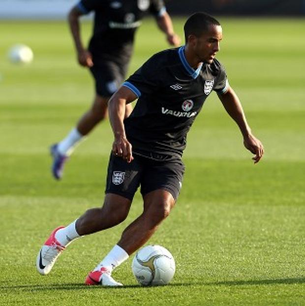 Theo Walcott, pictured, and Daniel Sturridge missed training through illness