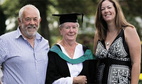 72-year-old Wendy Boycott with husband Bryn and daughter Sian receiving her degree . Picture by Mission Photography