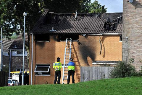 CWMBRAN FIRE: Officers at the burnt out house on Tillsland, Coed Eva in Cwmbran