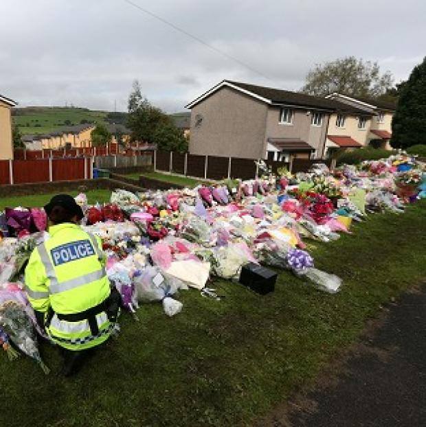 A vigil will be held close to the crime scene in Abbey Gardens, Tameside, where two police officers were shot