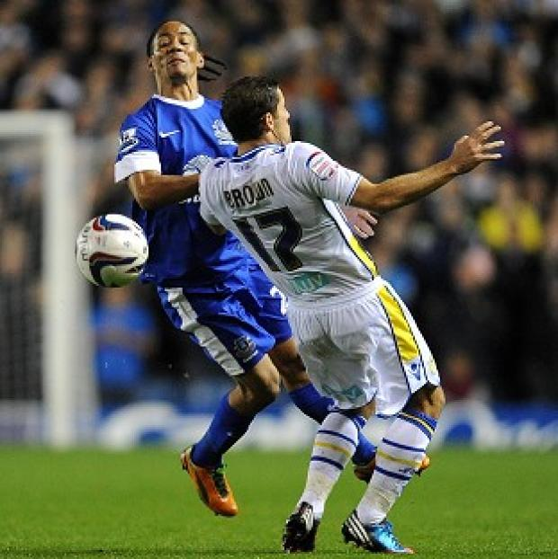 Steven Pienaar, left, and Michael Brown tussle in Leeds and Everton's Capital One Cup match