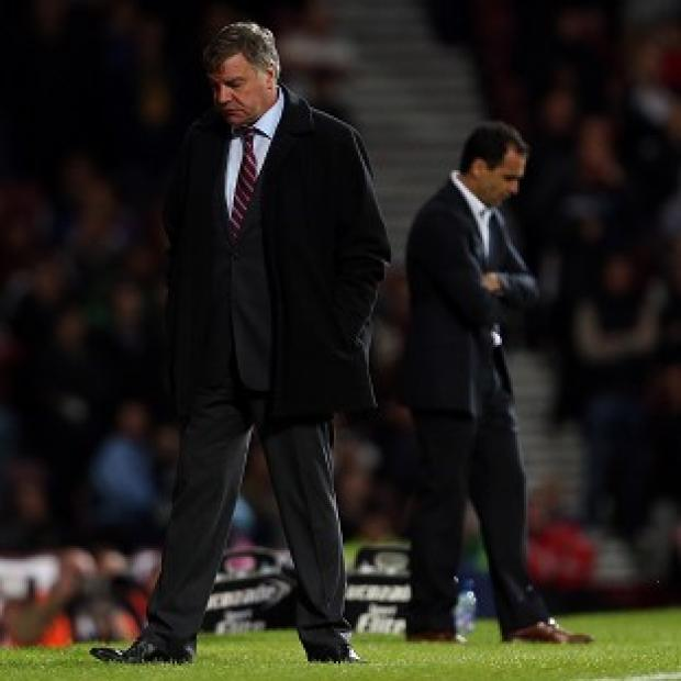 Sam Allardyce, left, was left frustrated by West Ham's loss to Roberto Martinez's Wigan