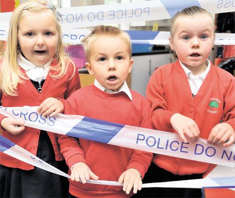 POLICE ACADEMY: Pupils; Ciara Hall, left, Joshua Felvus and Nancy-May James