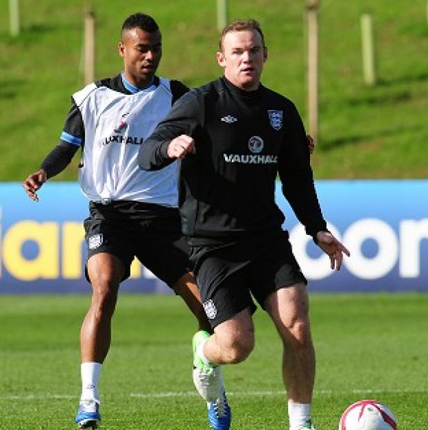 Wayne Rooney, right, wants to take a leadership role with England