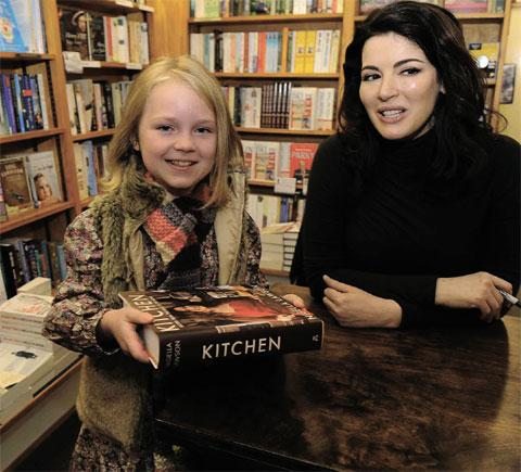 CULINARY STAR: Nigella with a young fan at her booksigning
