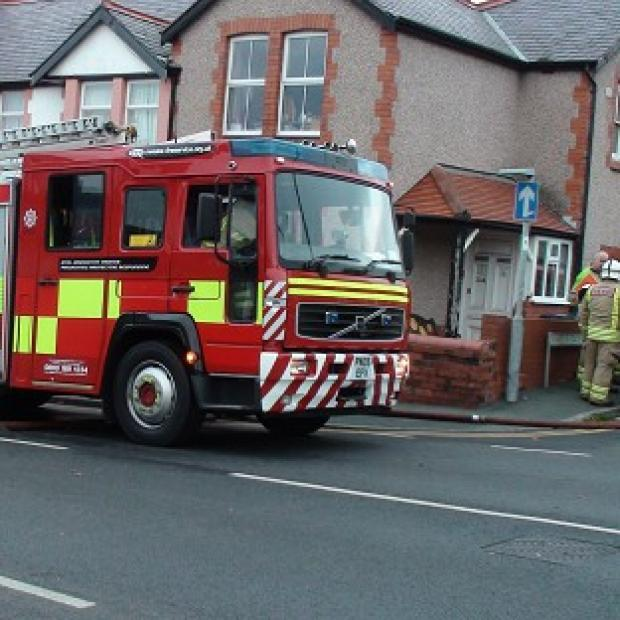 Firefighters in attendance at a house in Prestatyn where a 20-year-old woman, a boy aged four and a two-year-old girl were pronounced dead