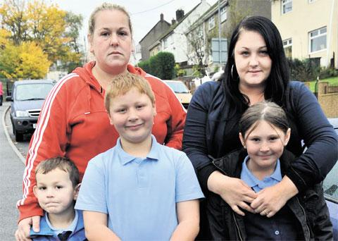 OPPOSING CLOSURE PLANS: Kate Taylor with her sons Brodey, eight, and Caleb, five, and Kelly Beaumont with her nine-year-old daughter, Ellie