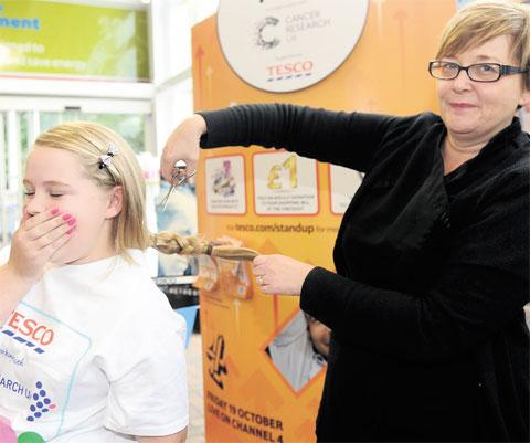 CHOP SHOCK: Kiah has her hair cut in aid of charity