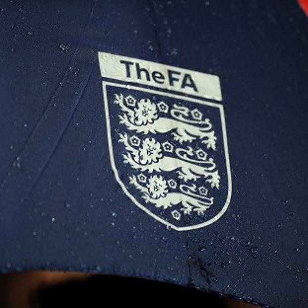 The FA confirms two players and a coach charged by Serbia police