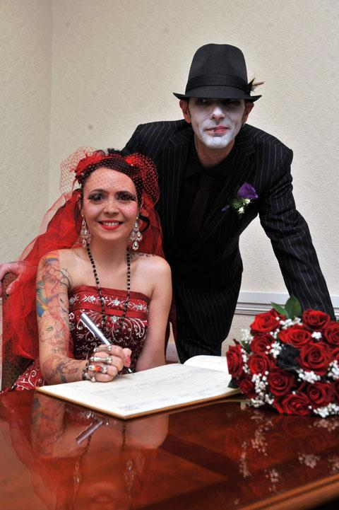 The groom, Michael Jenkins, known as Jinx and Catherine Page, known as Cat