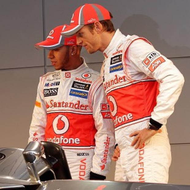 Jenson Button, right, believes Lewis Hamilton's departure will be a big loss to McLaren