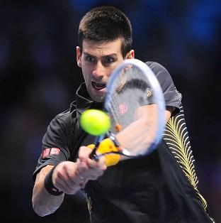 Novak Djokovic is through to the semi-finals of the ATP World Tour Finals