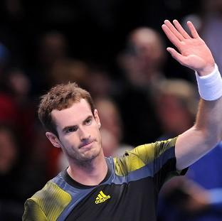 Andy Murray waves to the crowd after defeating France's Jo-Wilfried Tsonga at the O2 Arena