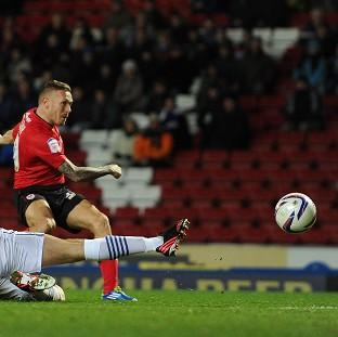 Craig Bellamy, right, puts Cardiff back ahead by rifling home their second of the night