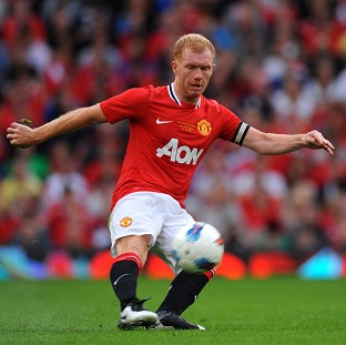Sir Alex Ferguson does not believe Paul Scholes, pictured, will retire at the end of the season