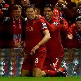 Steven Gerrard, left, and Luis Suarez, right, netted in Liverpool's victory over Fulham
