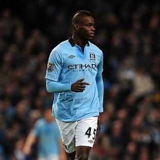 Mario Balotelli is staying at Manchester City
