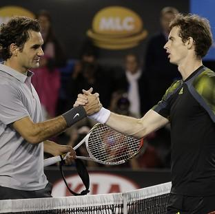 Andy Murray, right, defeated Roger Federer, left, in five sets (AP)