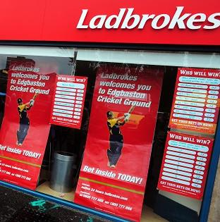 Free Press Series: A masked armed robber collapsed and died after being disarmed and pinned down by customers in a Ladbrokes bookies