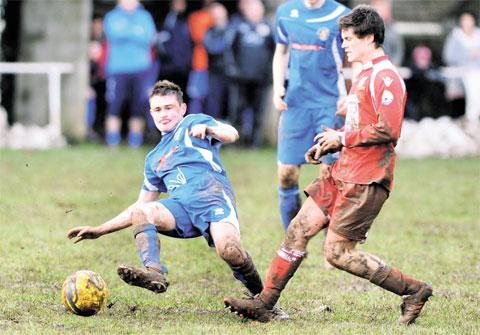 COMMITMENT: Chepstow's Rob Thorn flies into a tackle