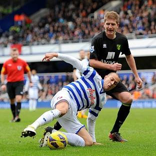QPR's Bobby Zamora, left, and Norwich's Michael Turner battle for the ball during their goalless draw